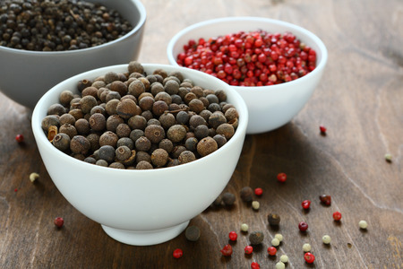 peppercorns: Mixed peppercorns in a bowls, wooden background