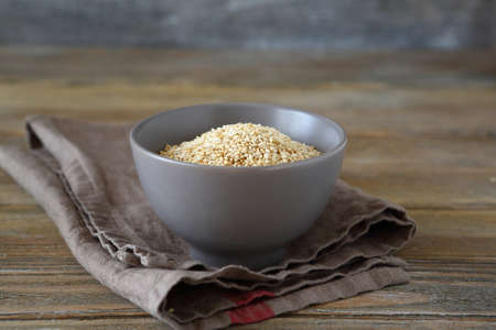 roasted sesame: Roasted sesame seeds in a bowl on wooden boards, food