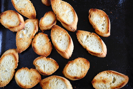 baking tray: Crispy baked baguette slices on a baking tray, delicious food