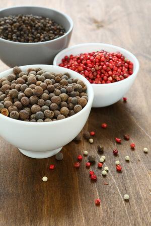 peppercorns: Peppercorns assorted in bowls, spice