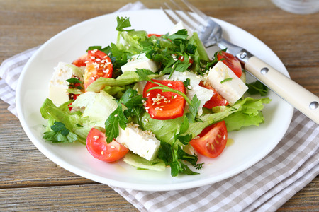 salad plate: Salad with tomatoes, peppers and cheese, healthy food Stock Photo