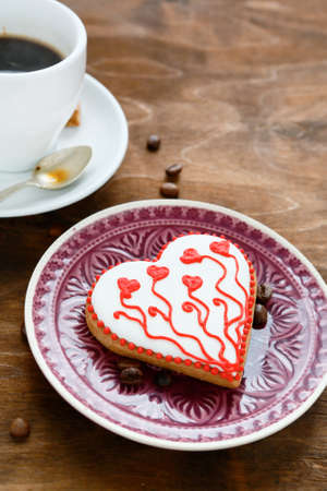 Tasty cookies on a plate with coffee, valentine day photo