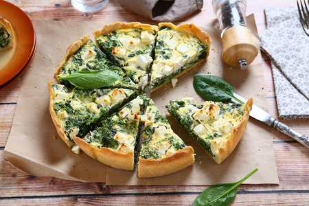 Pie with spinach and feta cheese, food Stock Photo