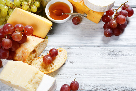 cheeseboard: Various types cheese on a background of boards, cheeseboard Stock Photo