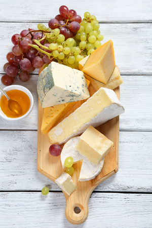 white board: Cheeses with honey and grapes
