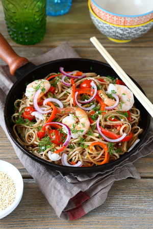 buckwheat noodle: Chinese buckwheat noodles with spicy shrimp in a frying pan