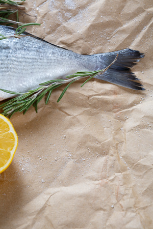 fish tail: Fish tail with rosemary and lemon, food