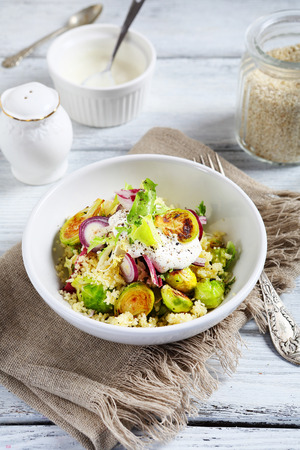 Couscous with brussels sprouts and onions, food Stock Photo