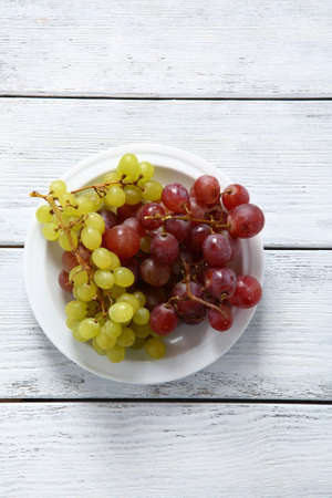 Grapes on a white plate, fruit photo