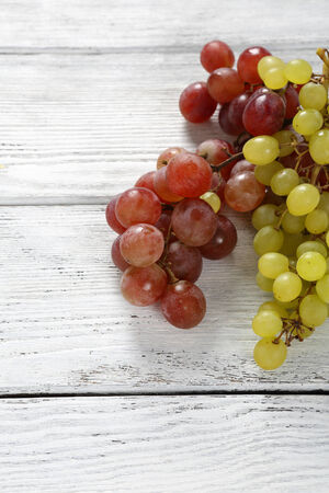 bunches: Tasty Grapes on white boards, fresh bunches Stock Photo