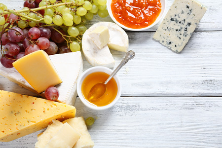 cheese platter: Gourmet cheeses with honey, food Stock Photo