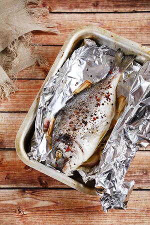 the dorada: Dorado with spice in baking dish, food