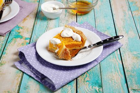 Sweet tart with pumpkin and cream, food photo