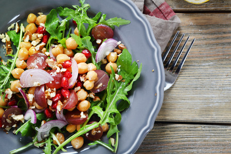 pomegranates: Salad in a plate on the boards Stock Photo