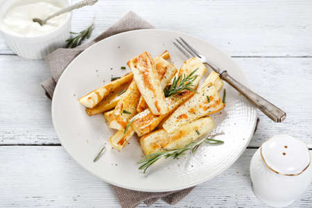 plate of food: Parsnips on a plate, food
