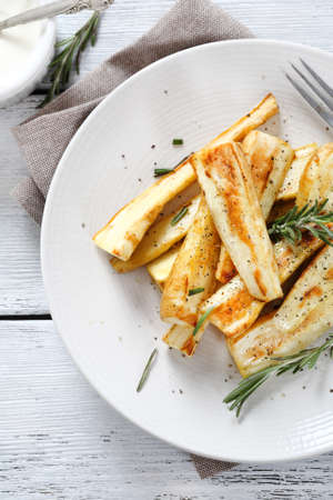 plate of food: Baked parsnips on plate, food Stock Photo