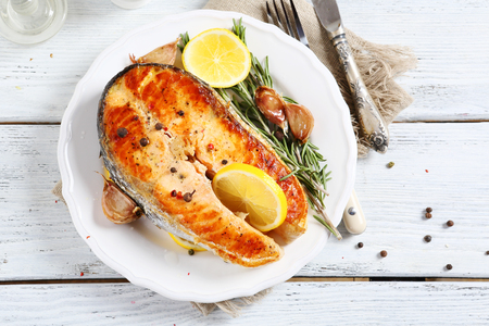 plate of food: Salmon with lemon on a plate, food
