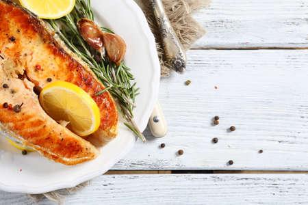 plate of food: Salmon on a plate, food