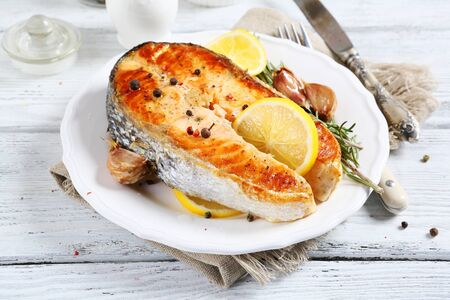 plate of food: Baked salmon on a plate, food