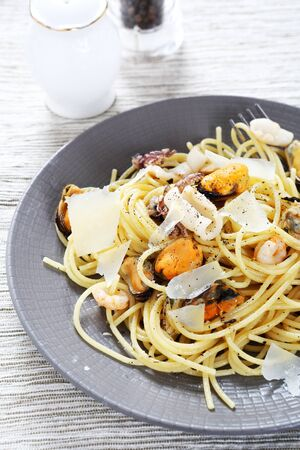 plate of food: Pasta with seafood on a plate, food