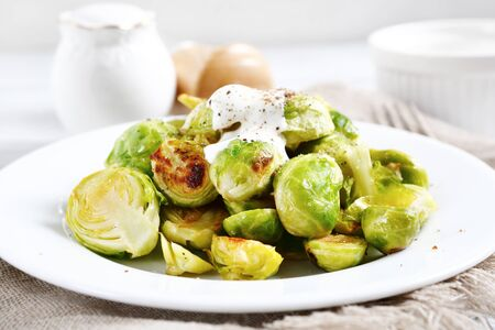 plate of food: Roasted Brussels sprouts on a plate, food