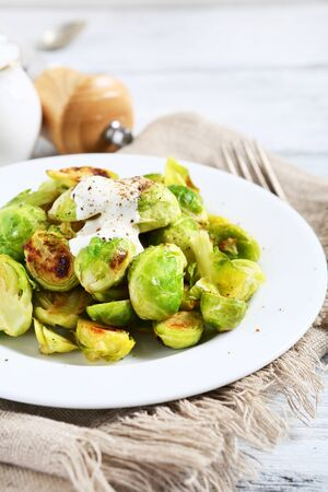plate of food: Brussels sprouts roasted with sauce on a plate, food Stock Photo