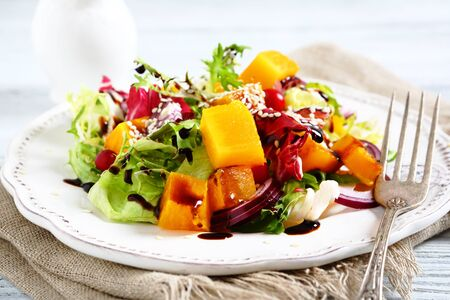 diet dinner: Salad with slices of pumpkin on a plate, food Stock Photo