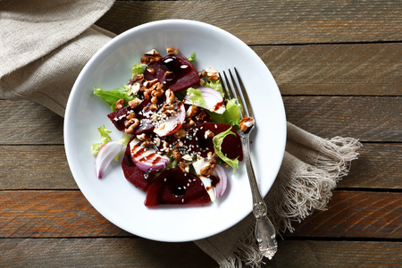 beets: Salad with beetroot and walnuts on a plate, food