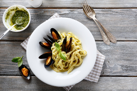 tops: Nutritional pasta with seafood top view Stock Photo