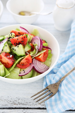 plate of food: Salad with cucumbers on a plate, food