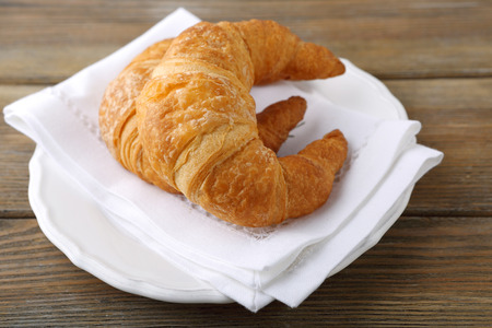 plate of food: Two fresh croissant on a plate, food Archivio Fotografico
