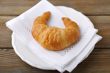 plate of food: Croissant on a white plate, food Archivio Fotografico