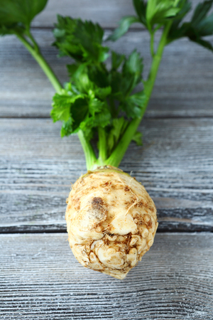 celery root: Celery root on the boards, vegetarian food Stock Photo