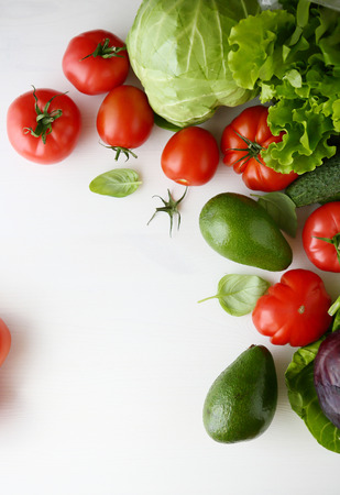 fresh vegetables on a white background, food top view