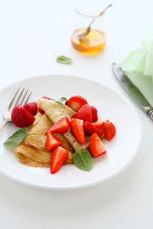 pancakes with fresh strawberries, summer food photo