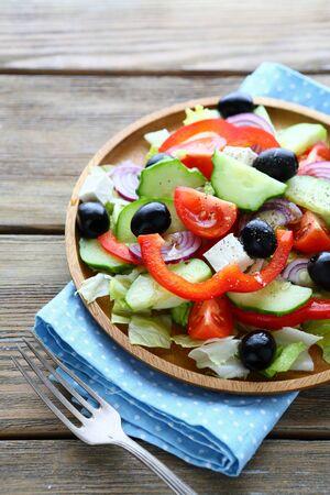 heathy: Greek salad on plate on wooden table