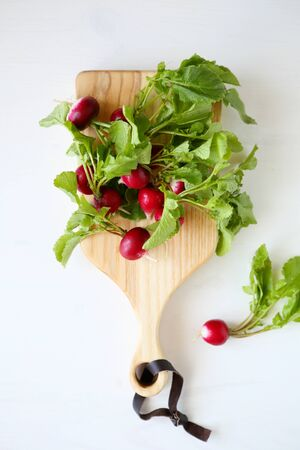 smal: fresh smal radish on cutting board top view