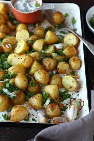 rustic food: baked potatoes with fresh herbs, rustic food