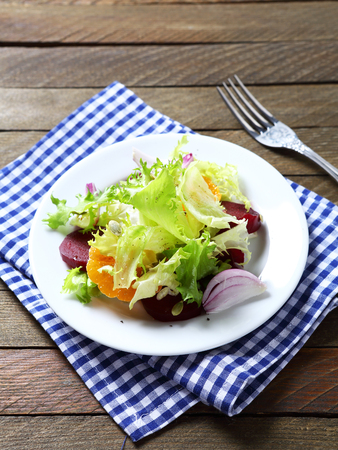 plate of food: Light salad with beetroot  on a plate, food