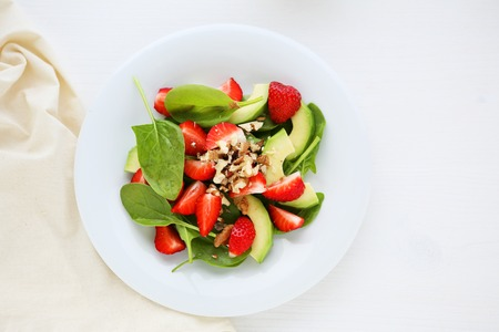 fresh spinach: summer salad with strawberries on plate, food Stock Photo