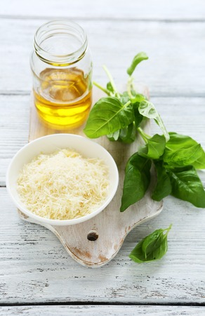 parmezan: Basil leaves with cheese and olive oil. Food