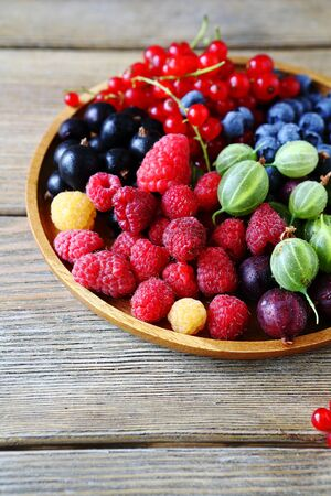 plate of food: mix summer berries on plate, food