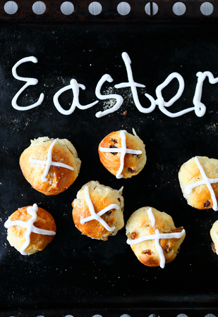 easter cross: easter hot cross buns on black background