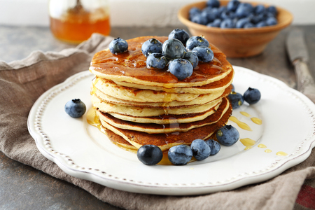 pancakes with honey on plate