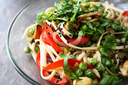 asian noodles: asian noodles with roasted seafood and vegetables, food closeup Stock Photo