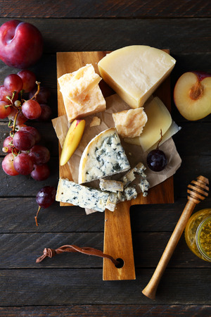 mix cheeses on rustic boards