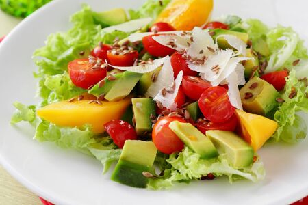 plate of food: salad with avocado on white plate, food close-up Archivio Fotografico