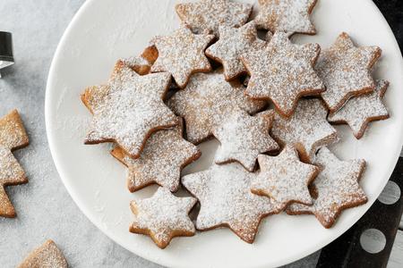 baking cookies: christmas star cookies on plate Stock Photo