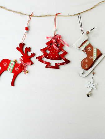 wooden vintage christmas decorations on white backdrop Stock Photo
