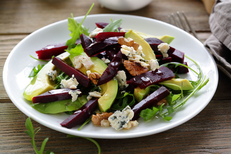 vegetable salad: baked beetroot salad with blue cheese and avocado, closeup
